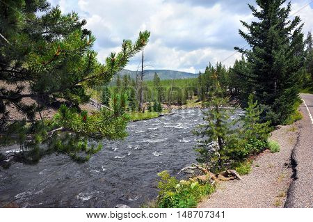 Firehold River races through the Firehole Canyon. Scenic Drive through Firehold Canyon yields awesome views.
