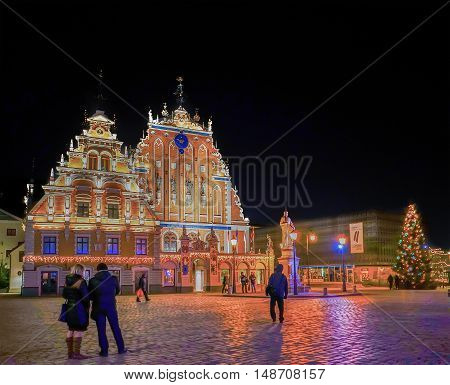 Christmas Tree At House Of Blackheads In Riga At Night