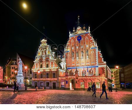 Riga Latvia - December 24 2015: House of the Blackheads during the Christmas in Riga Latvia at night.