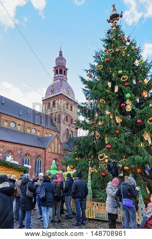 People Near Christmas Tree At Christmas Market In Riga