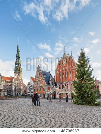 People Near House Of Blackheads And Christmas Tree In Riga