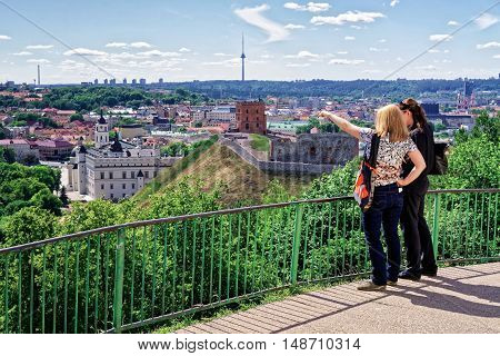 Women Viewing Gediminas Tower And Lower Castle Vilnius