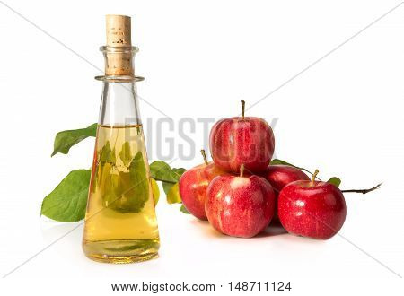 Apple Cider Vinegar In A Glass Vessel And Red Apples