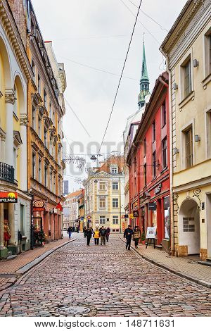 People Walking Around The Old Town Streets In Riga