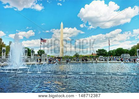 Fountain In Wwii Memorial With Washington Monument In Back