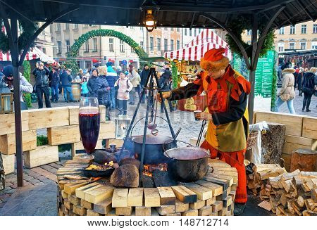 Man Dressed As Elf Serves Food At Riga Christmas Market