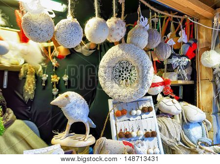 White Handmade Souvenirs At The Stall During Riga Christmas Market