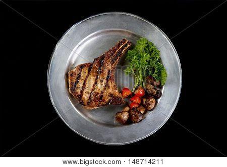 Fresh grilled pork chop ready to eat.