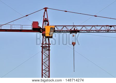 Construction crane close up on sky background