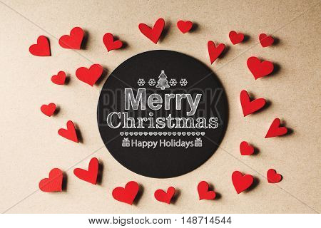 Merry Christmas message with handmade small paper hearts