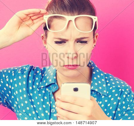 Young Woman Staring At Her Cellphone