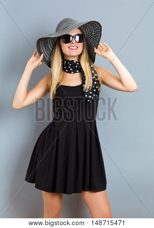 Happy Young Woman Wearing A Hat And Sunglasses