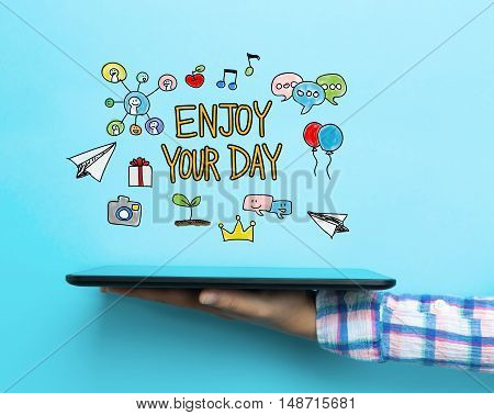 Enjoy Your Day Concept With A Tablet