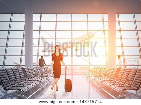 Beautiful businesswoman in black suit is standing with her luggage in airport and smiling. Large jet is taking off at the background. Concept of business trip. 3d rendering. Toned image