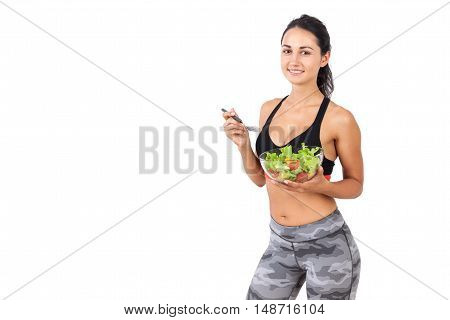 Smiling Girl With Salad Bowl And Fork
