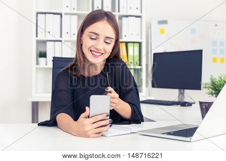 Smiling Office Employee And Her Phone
