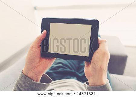 Man Reading A Book On E-reader
