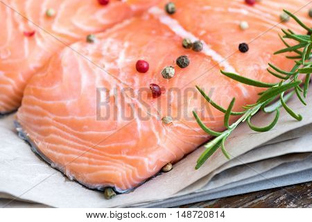 Detail of Raw Salmon Fish Fillet with Spices and Fresh Herbs Ready for Cooking