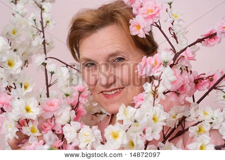 Elderly Woman  On A Pink