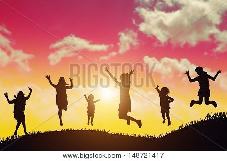 Silhouette Of Group Of Hipster Teenagers Jumping At The Sunset
