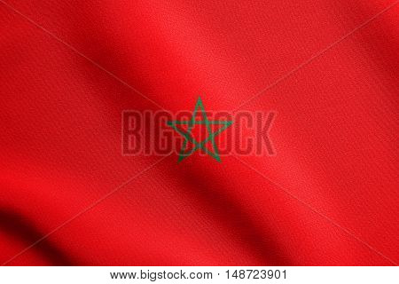 Moroccan national official flag. African patriotic symbol banner element background. Flag of Morocco waving in the wind with detailed fabric texture, illustration