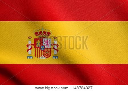 Spanish national symbol. Patriotic background design. Flag of Spain waving in the wind with detailed fabric texture, illustration