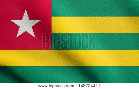 Togolese national official flag. African patriotic symbol banner element background. Flag of Togo waving in the wind with detailed fabric texture, illustration