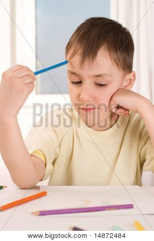 Boy With A Pencil Sitting And Draws