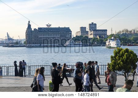 Istanbul Turkey - May 29 2016: The centre of Kadıköy today is the transportation hub for people commuting between the Asian side of the city and the European side across the Bosphorus. There is a large bus and minibus terminal next to the ferry docks. Fer
