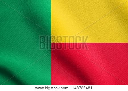 Beninese national official flag. African patriotic symbol banner element background. Flag of Benin waving in the wind with detailed fabric texture, illustration