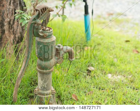 close-up Old  groundwater pump, green. in Thailand.