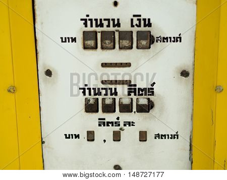 Close-up old yellow fuel dispenser. in Thailand.