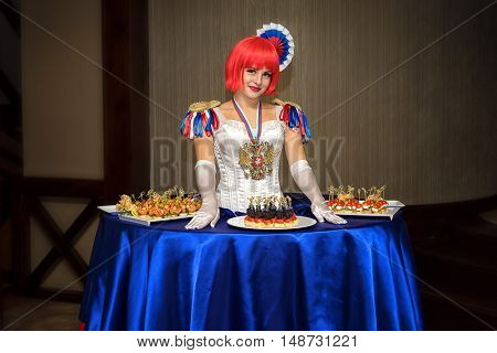 Moscow, Russia - September 18, 2016: Charming Lady Buffet, Who Dress Is Stylized Russian National Co