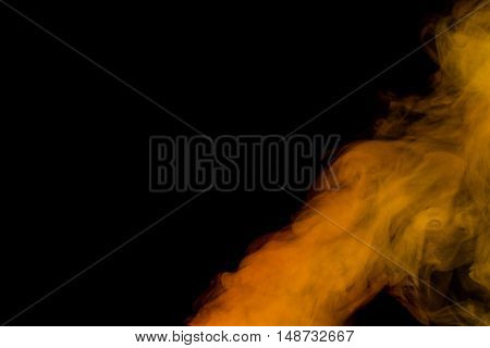 Abstract red yellow water vapor on a black background. Texture. Design elements. Abstract art. Steam the humidifier. Macro shot.