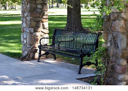 Bench in the park under a terrace