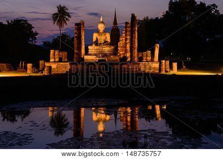 Buddha statue in Sukhothai historical park, twilight time.