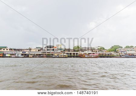 Bangkok Thailand - June 5 2016: Right hand side of Chao Phraya River on cloudy day. It is at the same side of Siriraj Hospital part of Mahidol university.