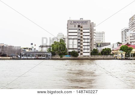 Bangkok Thailand - June 5 2016: The faculty of Nursing Mahidol university view from the other side of Chao Phraya River on cloudy day