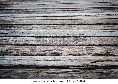 Old wooden bridge floor at the port.
