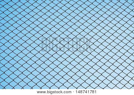 Silhouette steel net wire against gradient clear blue sky