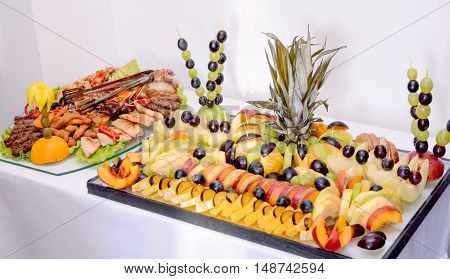 picture of a platters with different fresh fruits and meat