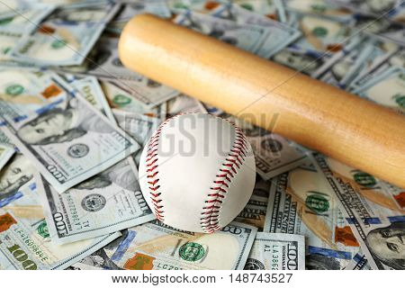 Baseball-bat and ball on dollars