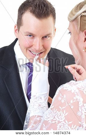 Groom Undressing Bride