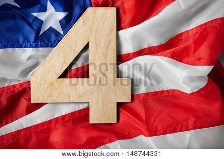 Independence day concept. Number 4 on American flag background