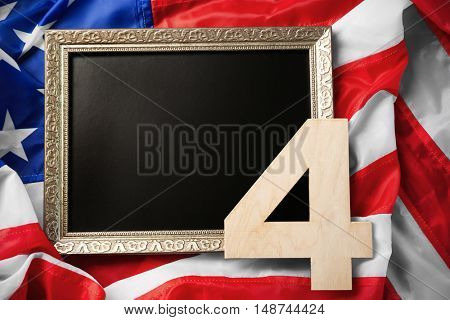 Independence day concept. Number 4 and blank frame on American flag background