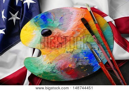 Paint and brushes on American flag background