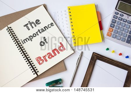Text The importance of brand on white paper book on table / business concept