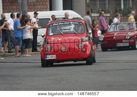 BELGRADE,SERBIA - SEPTEMBER 10, 2016:Old Fiat 500 at the commercial race of old cars in memory of formula 1 race held on the same place in 1939 two days after the beginning of Second World Warwhen the famous Italian driver Tazio Nuvolari won