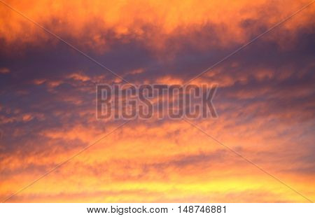 It changes color at sunset and clouds tinged with blood red.