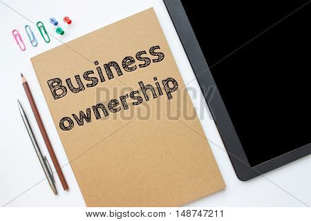 Text business ownership on brown paper book on table / business concept